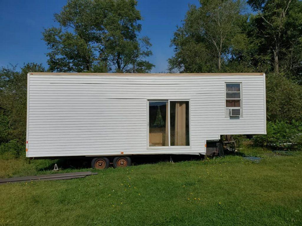White tiny house on wheels