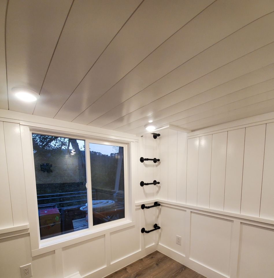 Window by white shiplap walls
