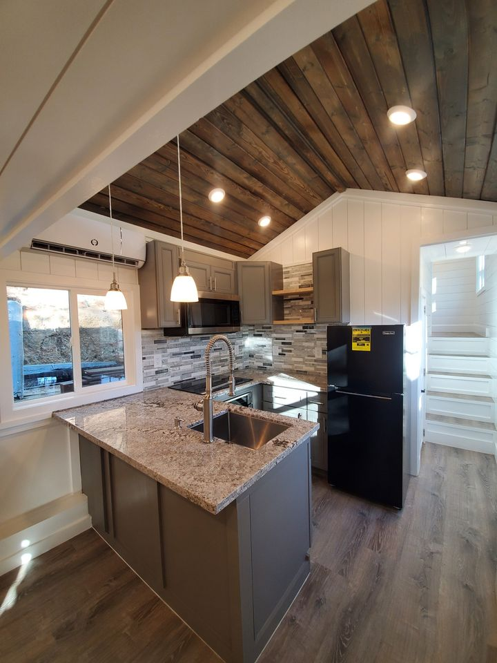 Tiny house kitchen with wood ceiling