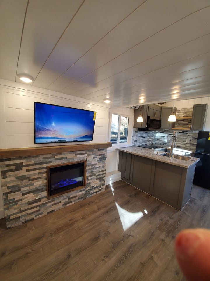 Fireplace in tiny home with tv above