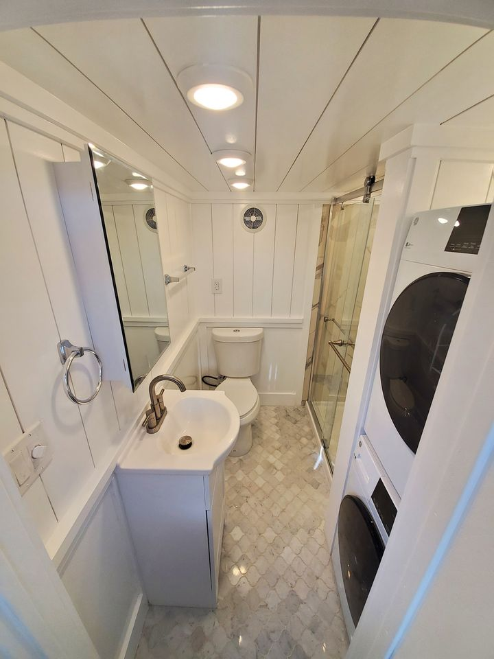 Tiny house white bathroom with laundry