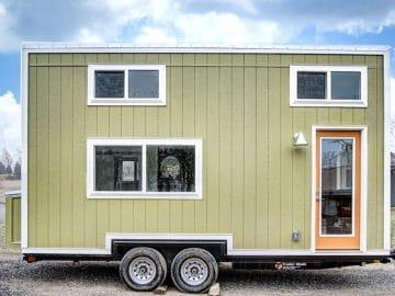 Green tinny house on wheels