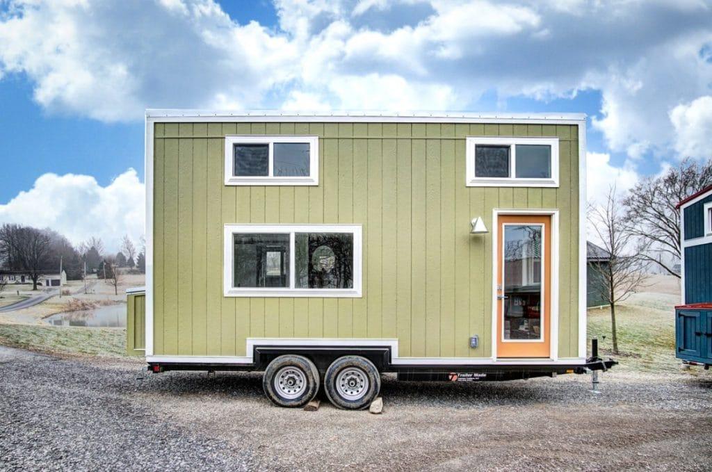 Green tiny house on wheels