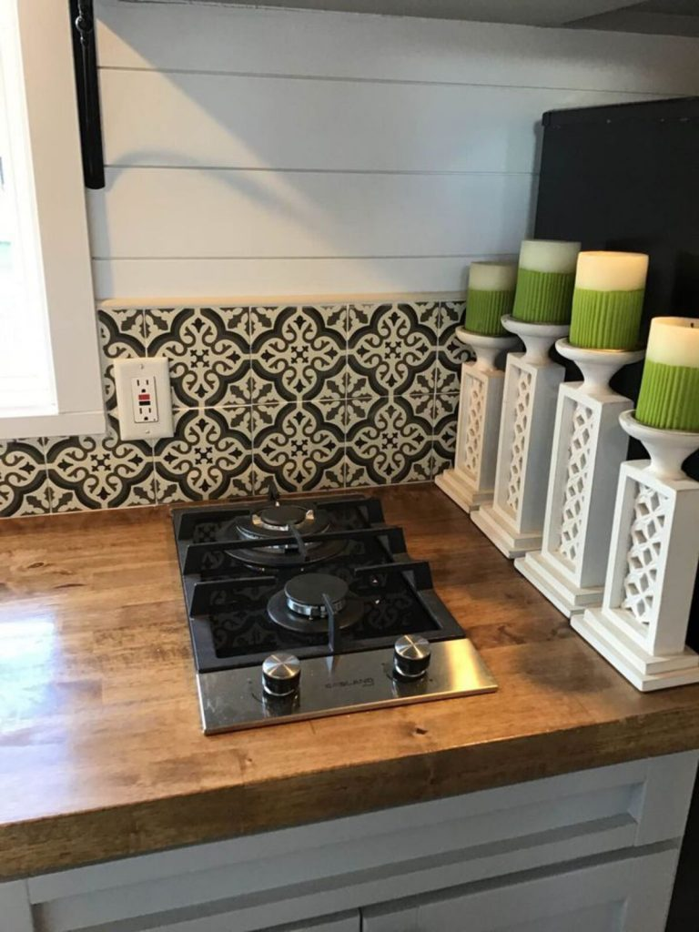 Two burner stove on butcher block counter