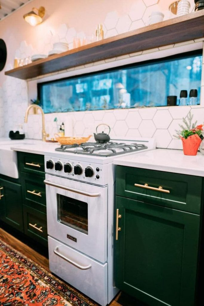 Kitchen stove and green cabinets