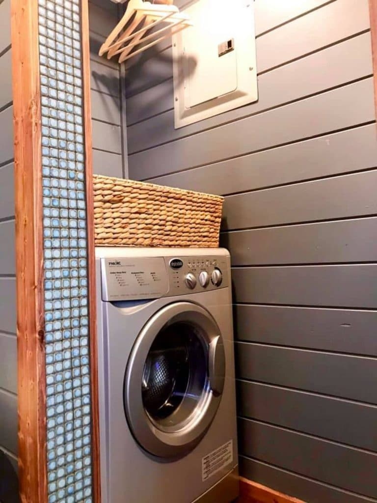 Laundry station with gray walls