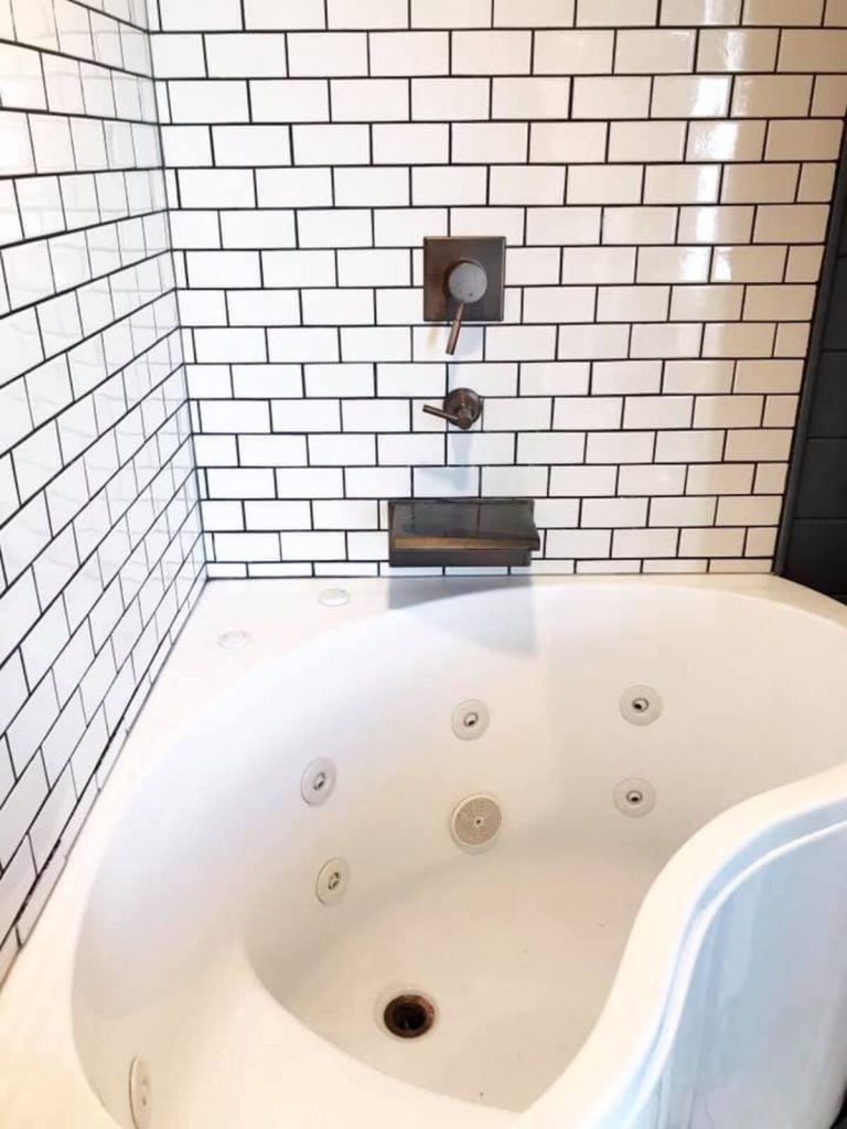 Soaking tub surrounded by moraccan tile