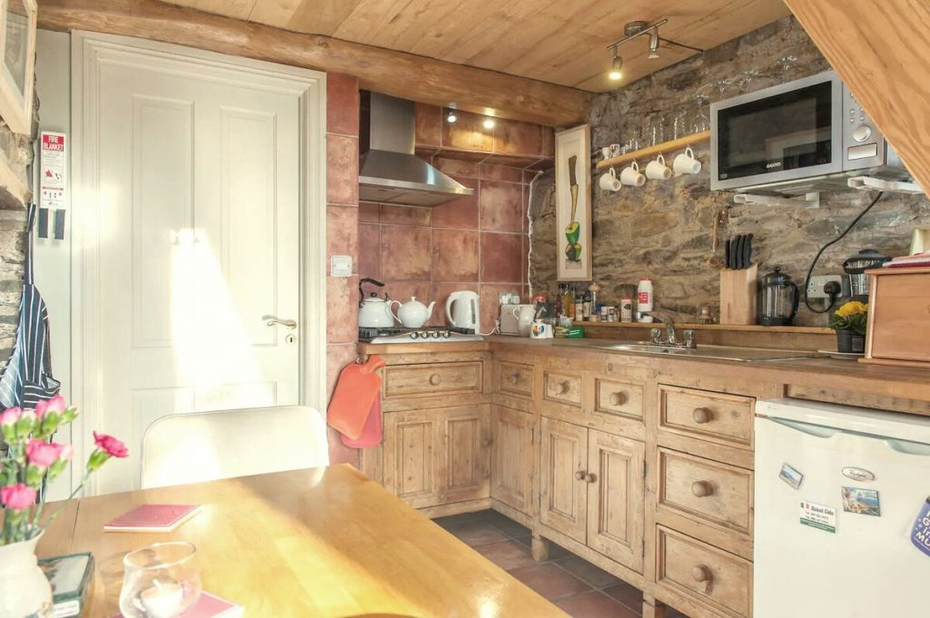 Kitchen cabinets in stone cottage