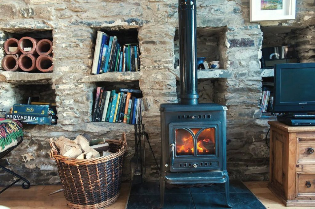 Wood fireplace in stone cottage