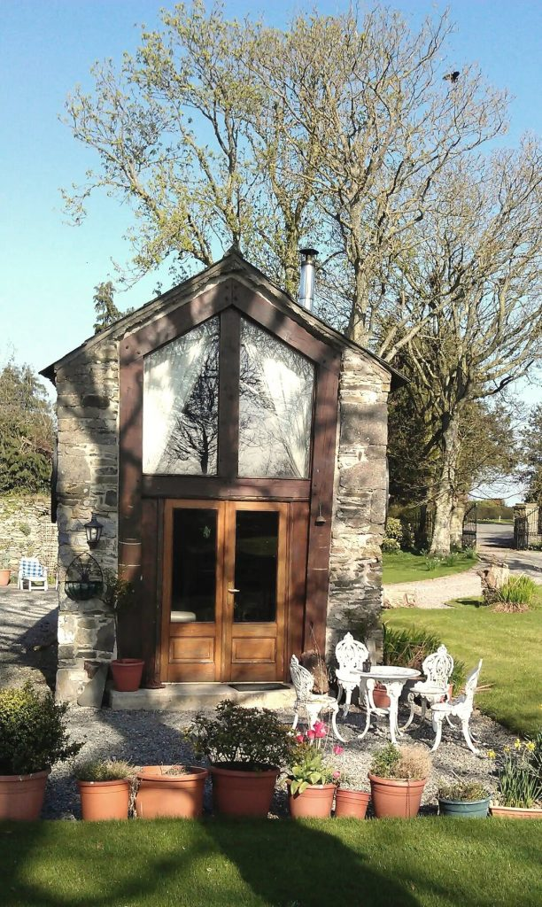 Front door to stone cottage tiny house