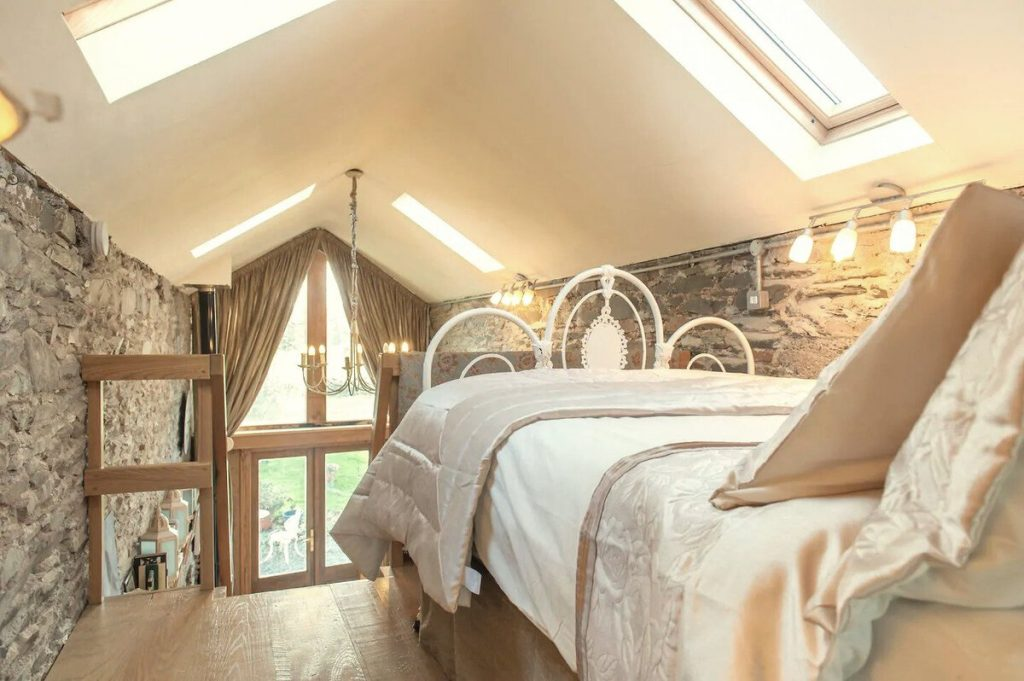 Loft bedroom in stone cottage
