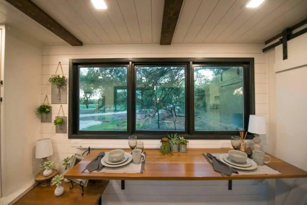 Tiny house table beneath windows