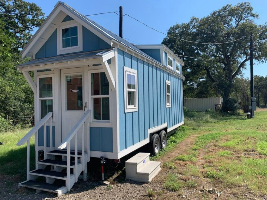 Blue tiny house with porch