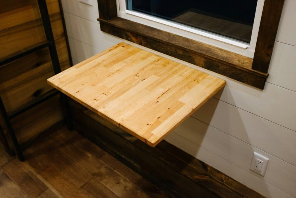 Folding table on wall