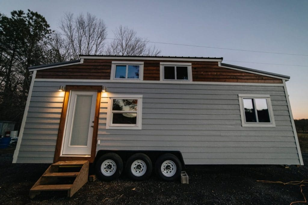 Grey tiny house with side door