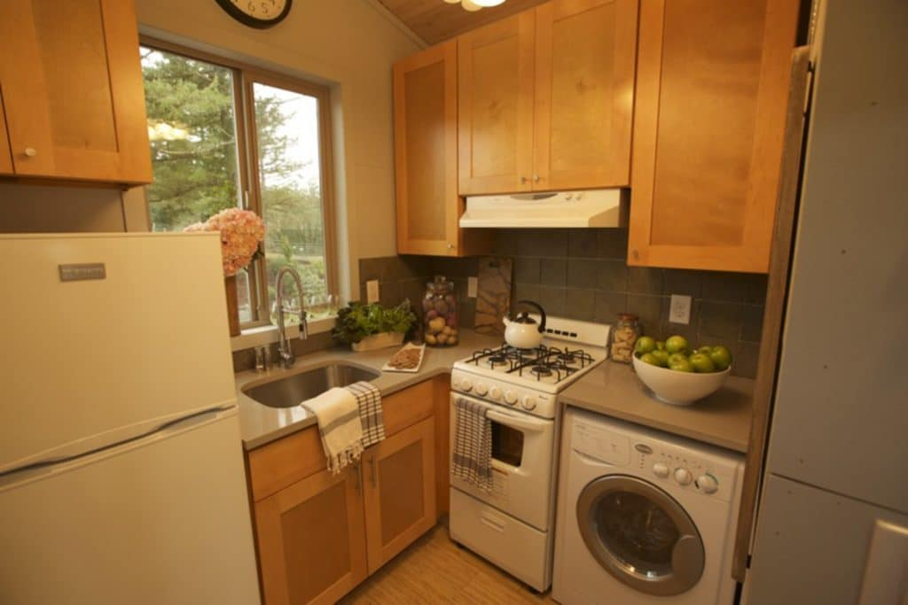 Tiny house kitchen with blonde wood