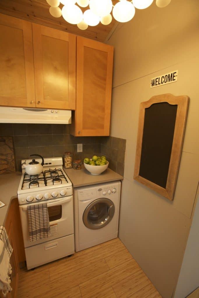 Stove and washing machine in kitchen