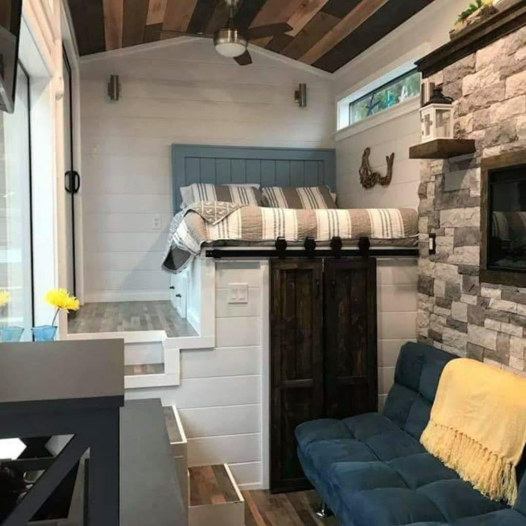 Loft bed with teal accents and fireplace