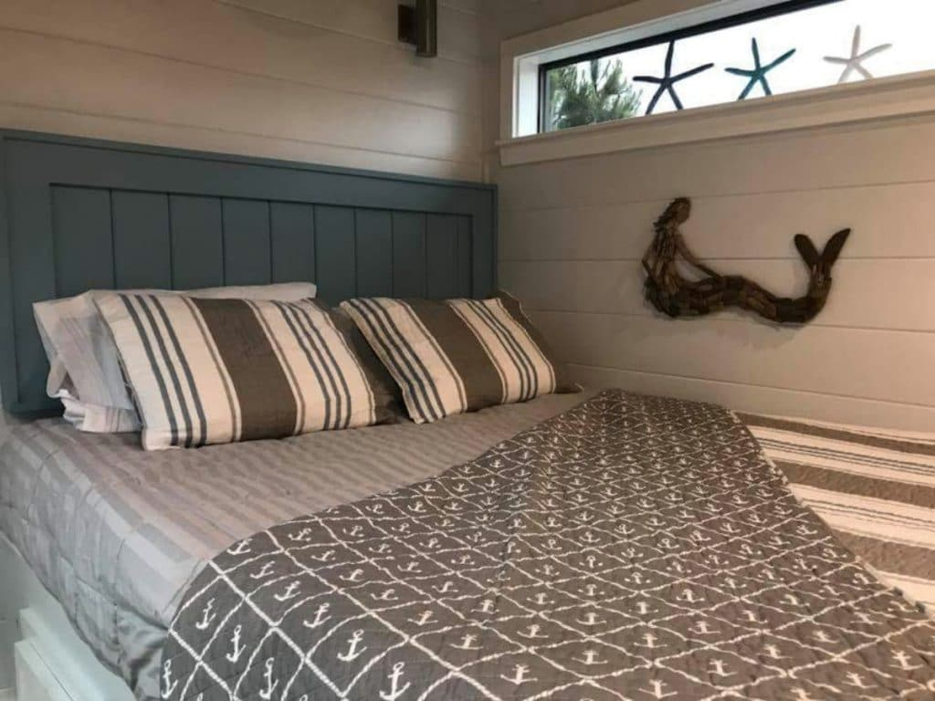 Bed with beach accents behind it