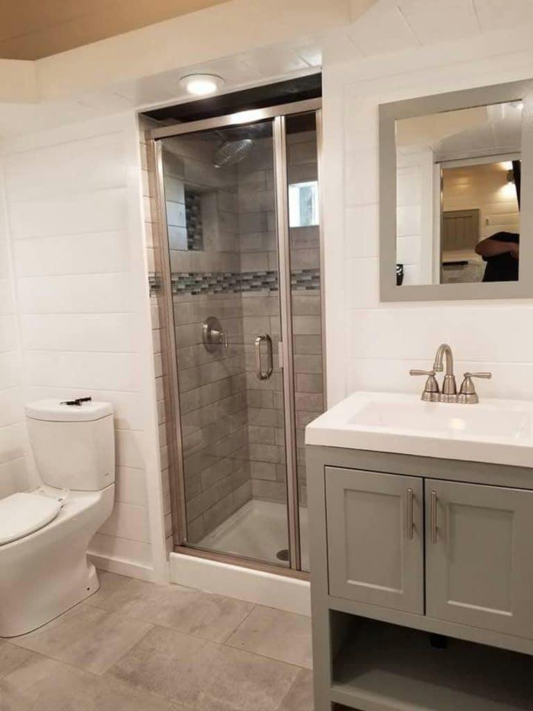 Tiny house bathroom with tile shower