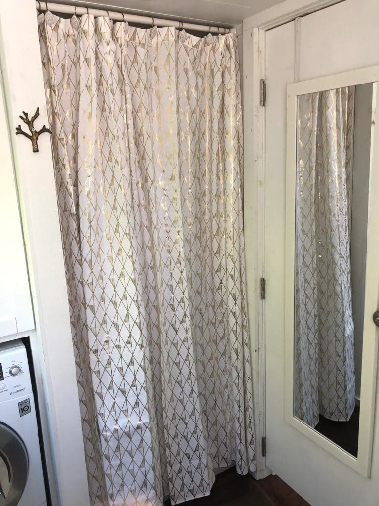 Shower curtain over shower stall