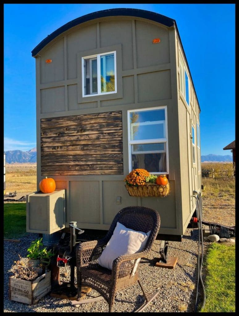Back of tiny house with fall decor