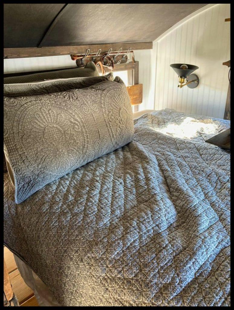 Grey bedding on tiny house
