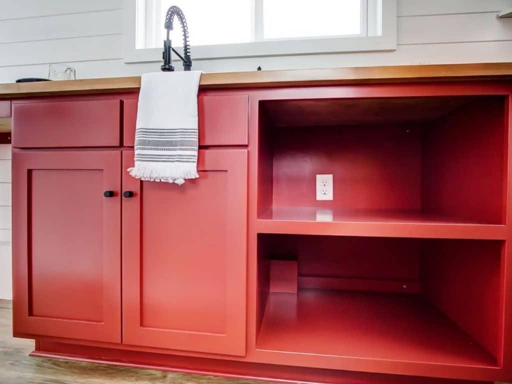 Red cabinet under sink