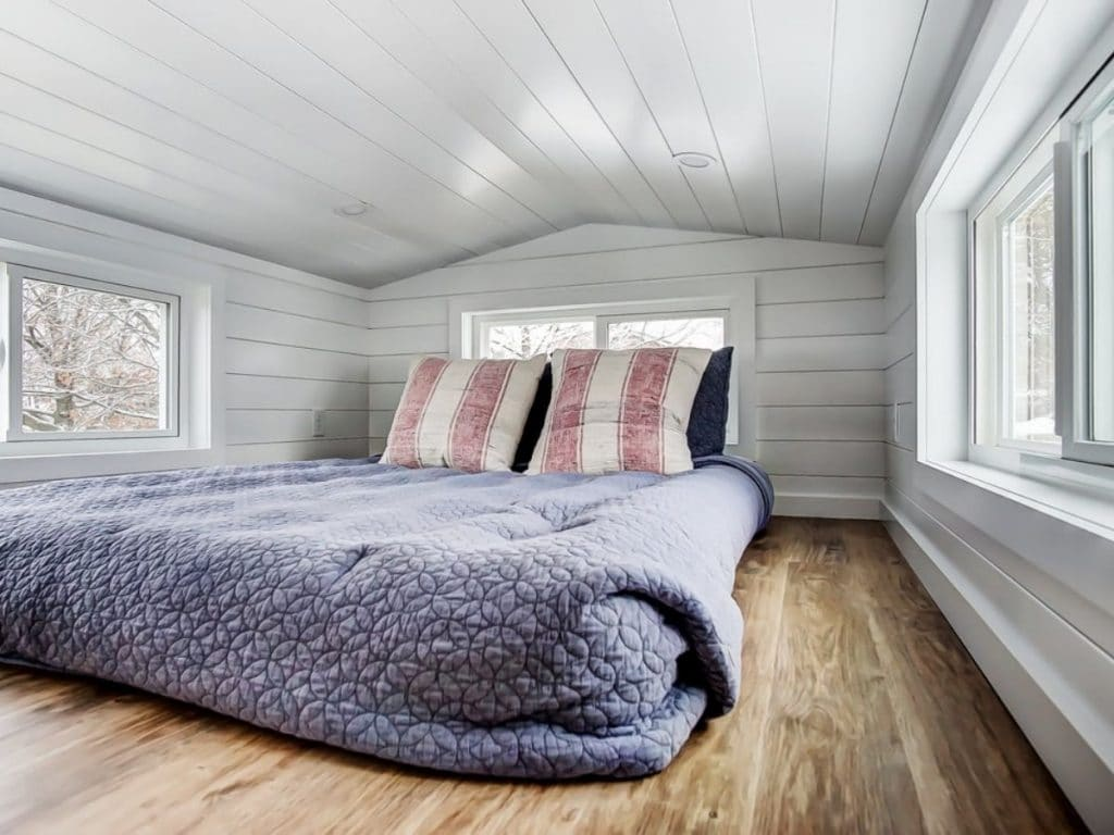 Blue bed in loft tiny house