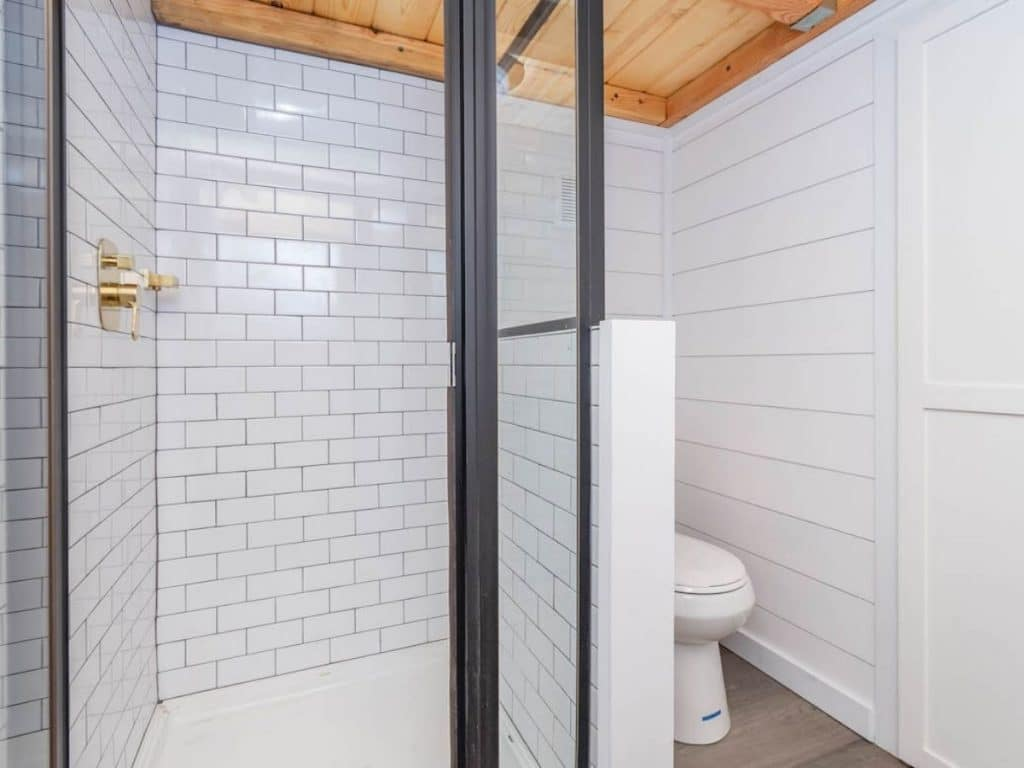 Tiled shower with black trim