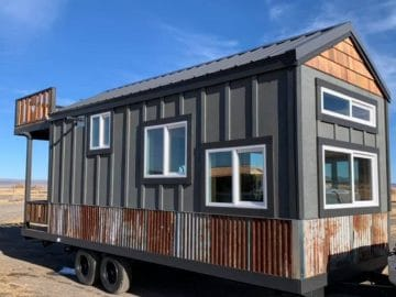 Blue and wood tiny house on wheels