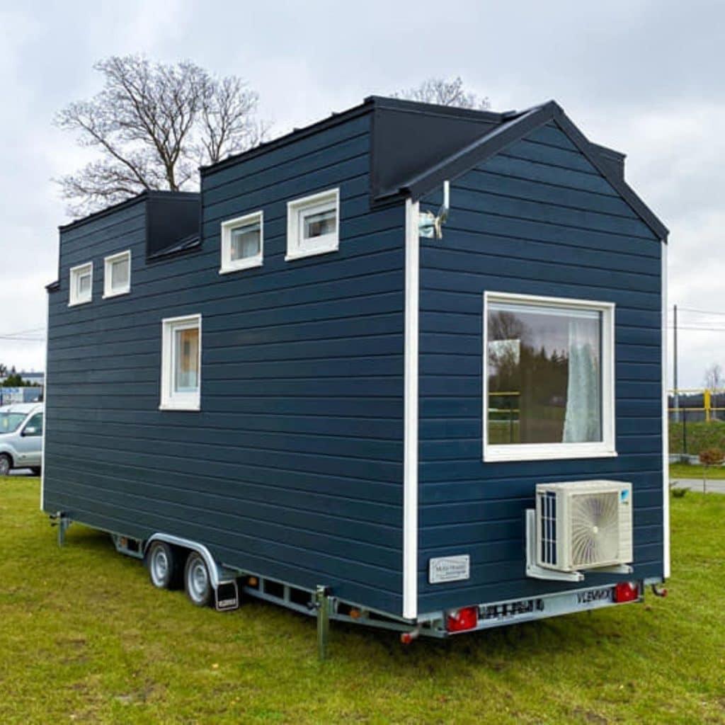 Dark teal house on wheels