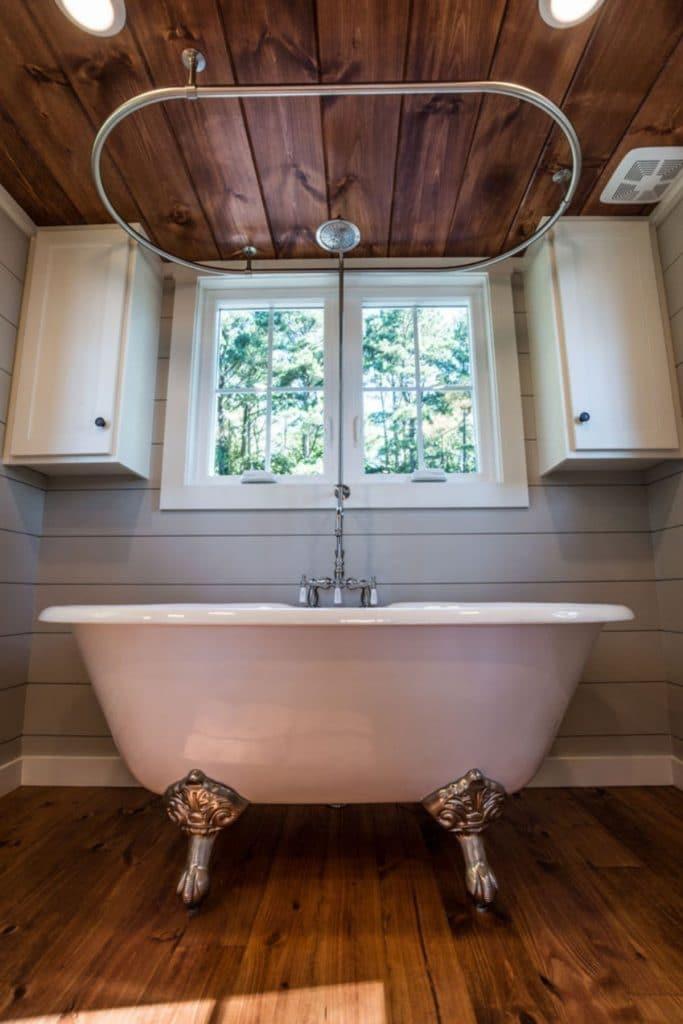 Clawfoot bathtub in tiny house bathroom