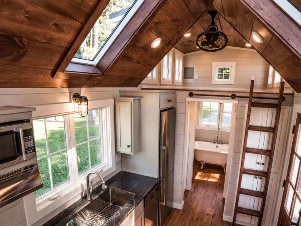 Tiny house loft with wood ceiling