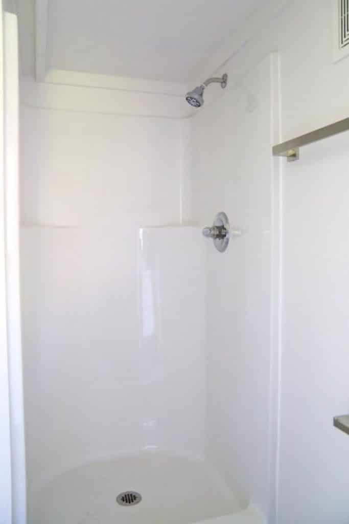White shower stall in tiny house