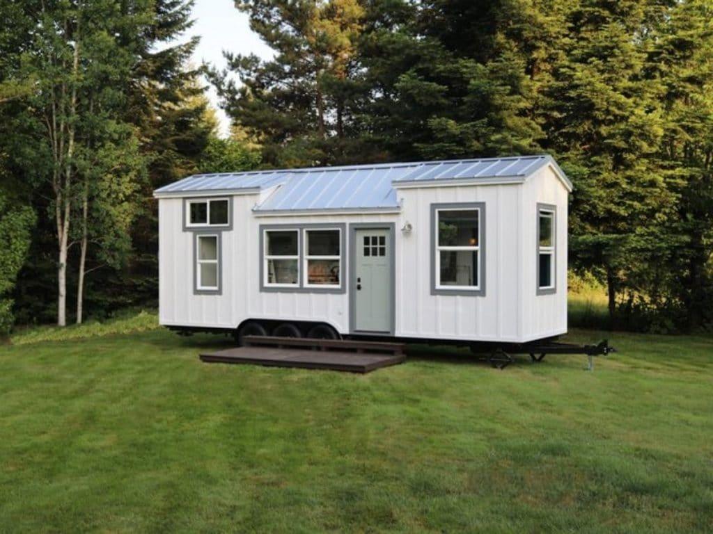 Tiny house with white siding