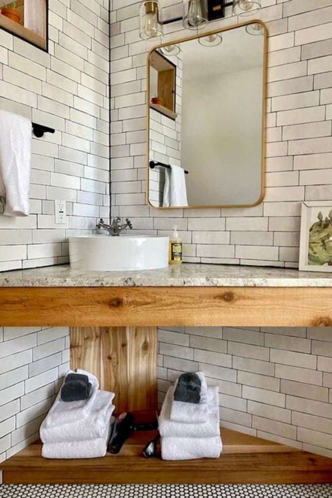 Tile lined the Acorn tiny home bathroom with sink