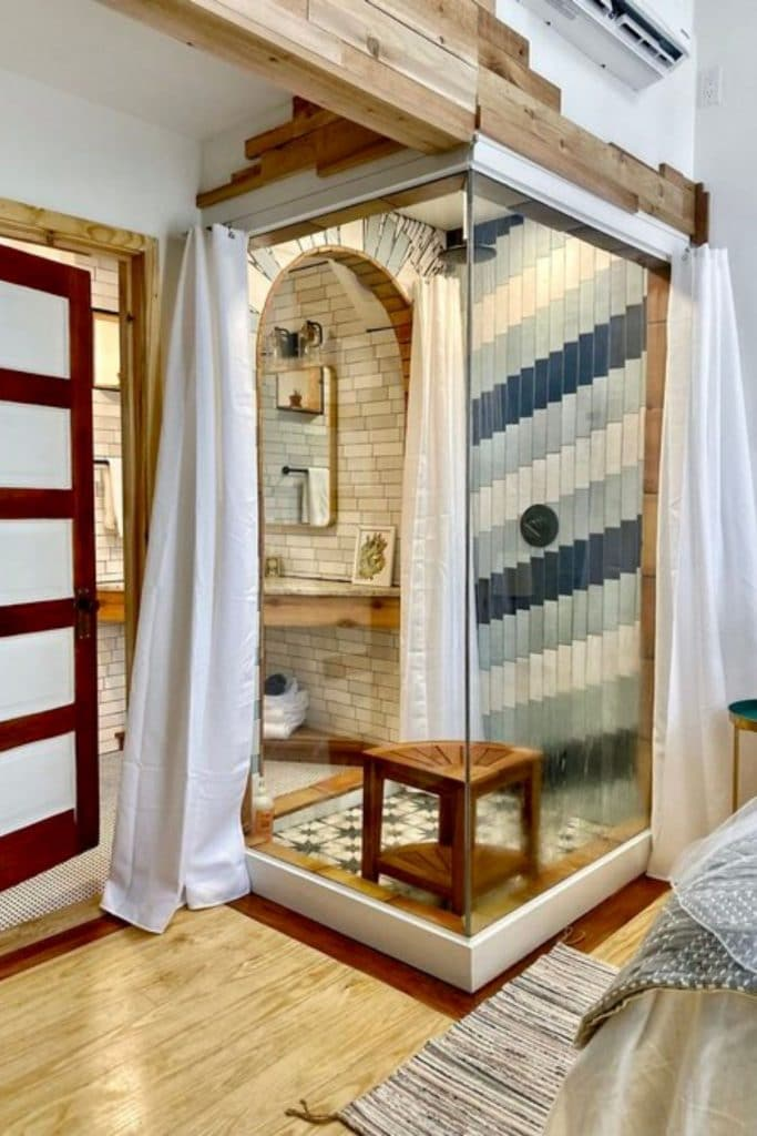 Tiled lined shower in the Acorn tiny home