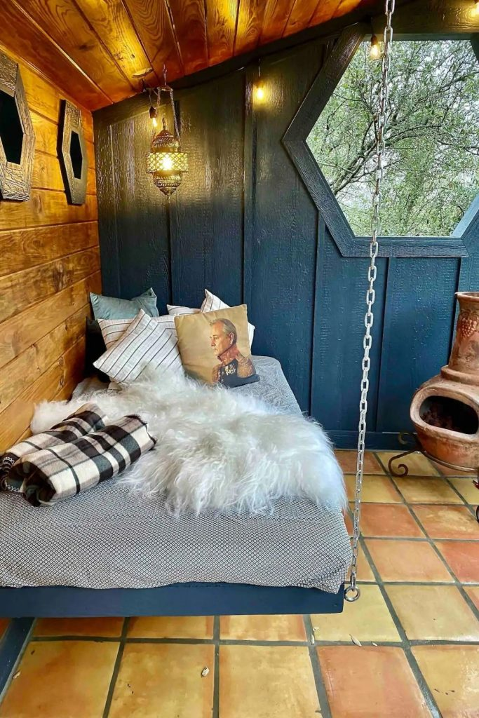 Floating bed in the Acorn tiny home with cushions