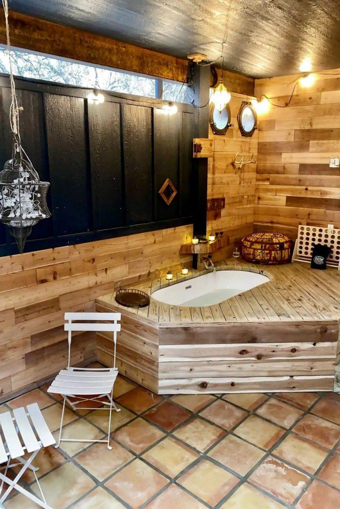 The Acorn tiny home wood lined bathtub
