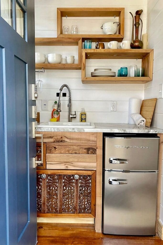 The Acorn kitchenette with large sink and apartment refrigerator