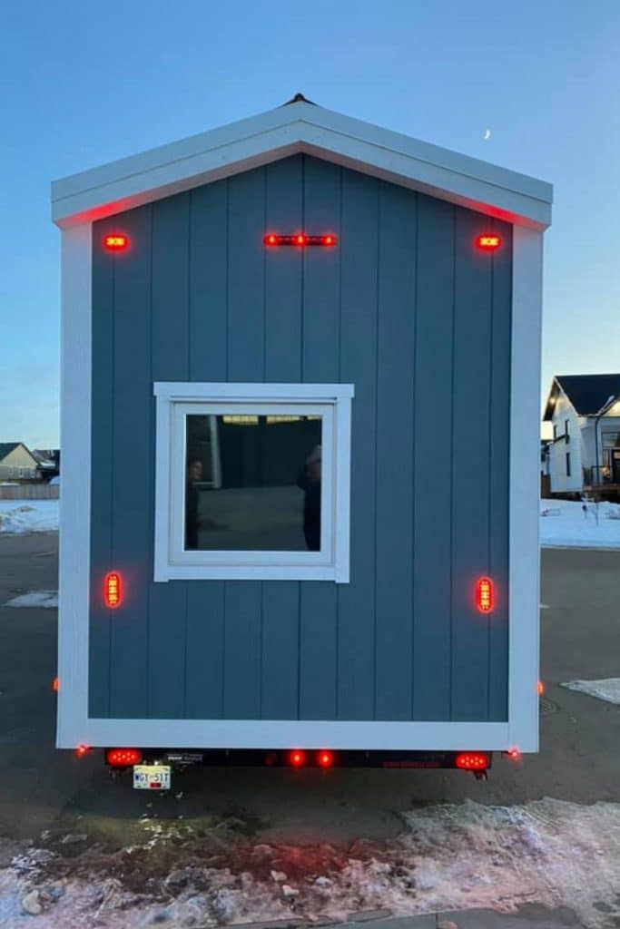 Blue tiny house on wheels