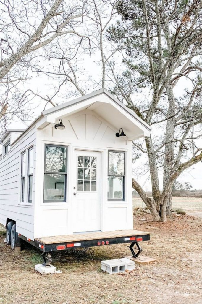 White tiny house on wheels