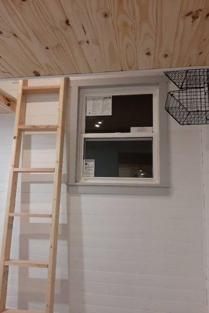 Ladder by window