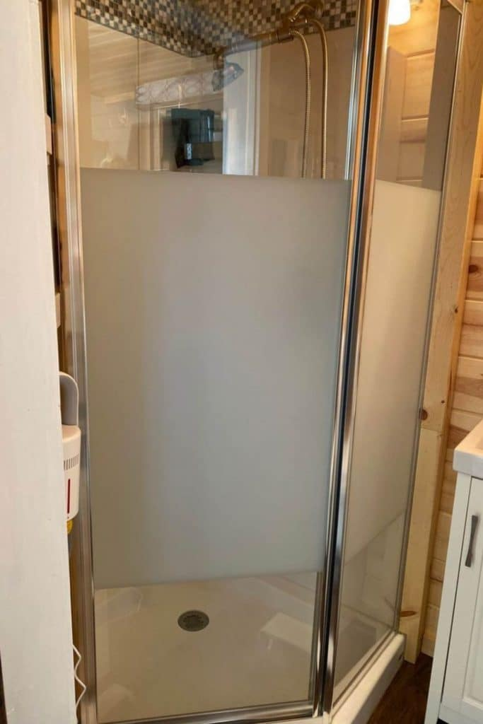Corner tiny house shower