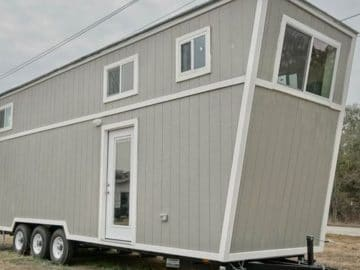 Grey tiny house on wheels