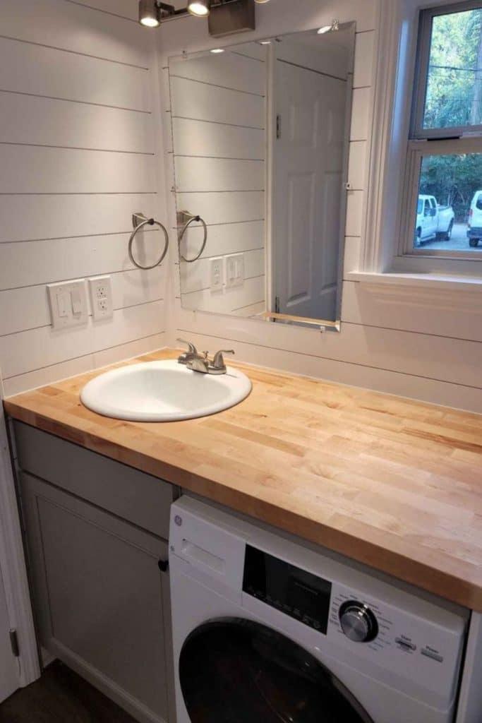 Bathroom vanity with washer