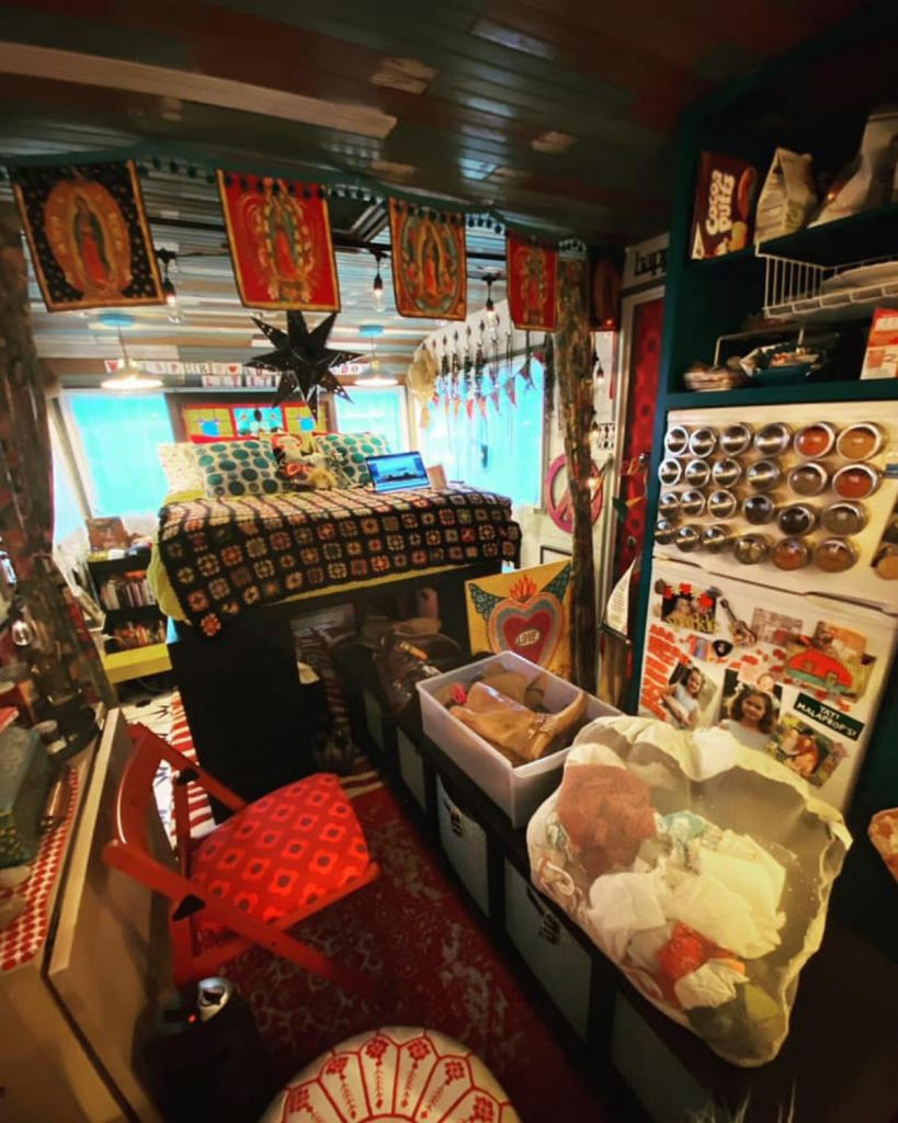 Tiny home decorated with colorful batnners inside