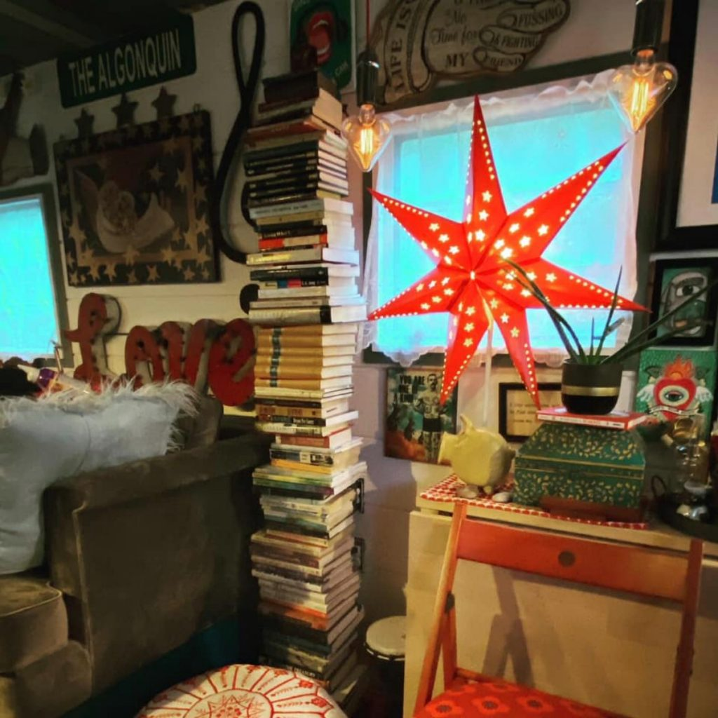 Red star in window surrounded by stacks of books