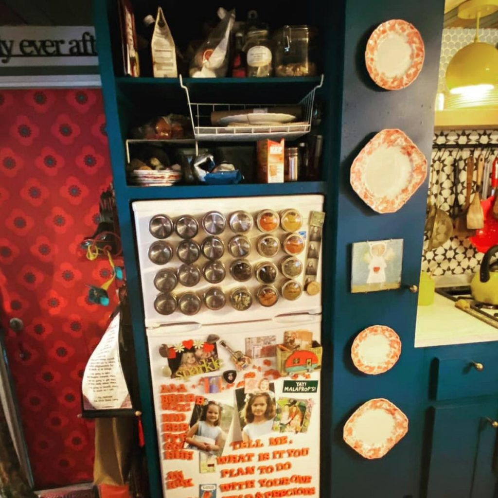 Tiny refrigerator with magnetic spice jars